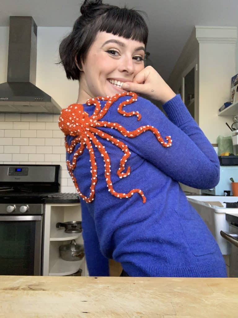 atlantic white-spotted octopus knitted onto a sweater